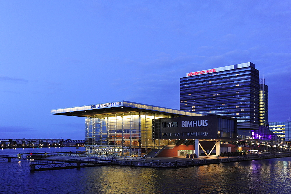 Modern architecture at the IJ lake, complex of buildings for music, Muziekgebouw aan het IJ and Bimhuis building, Moevenpick Hotel in the background, Amsterdam, Holland, the Netherlands