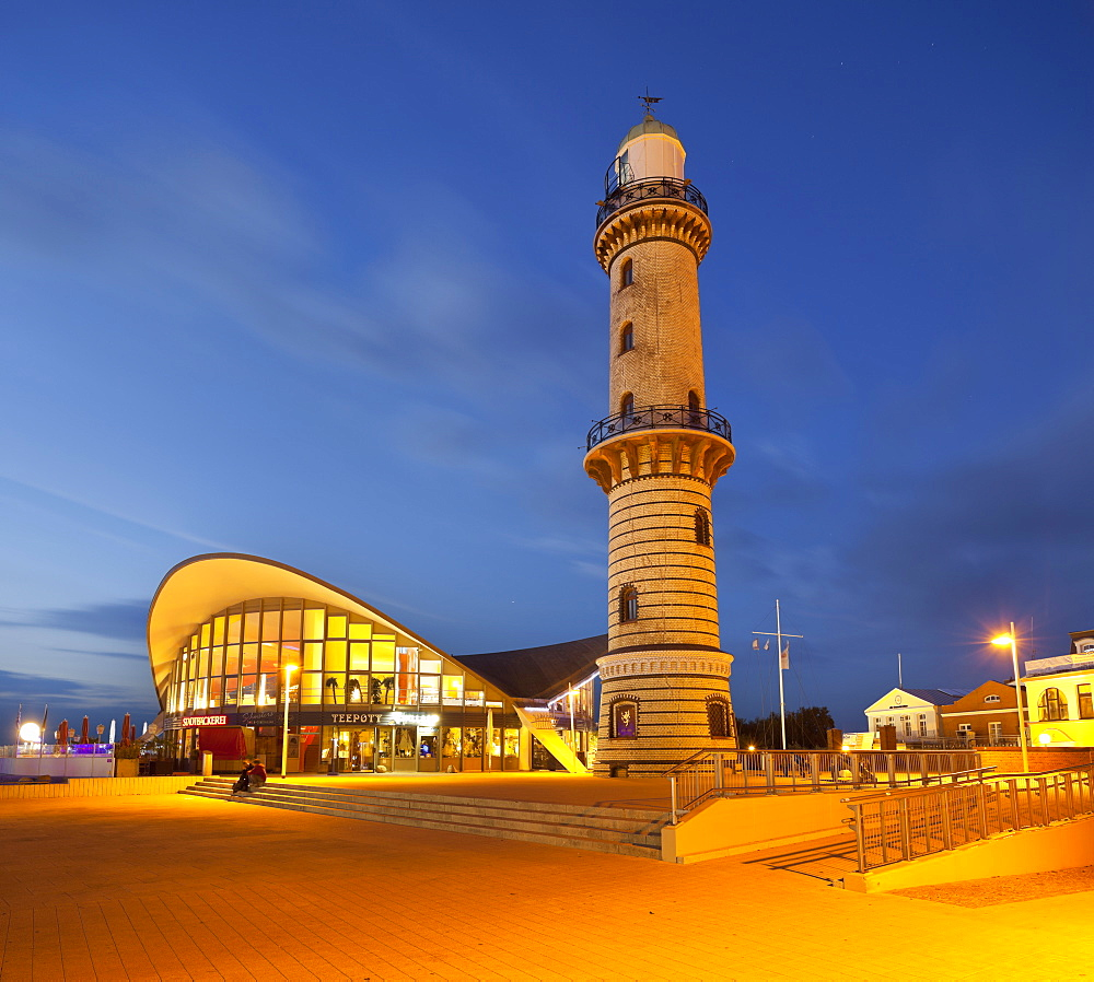 Warnemuende lighthouse and teapot at night, Warnemuende, Mecklenburg-Vorpommern, Germany