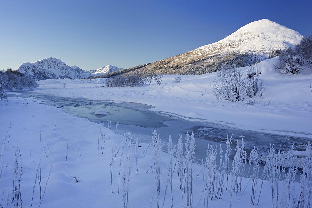 Winter landscape near Leknes, Lakselva river, Holandsmelen mountain, Vestvagoya, Lofoten, Nordland, Norway