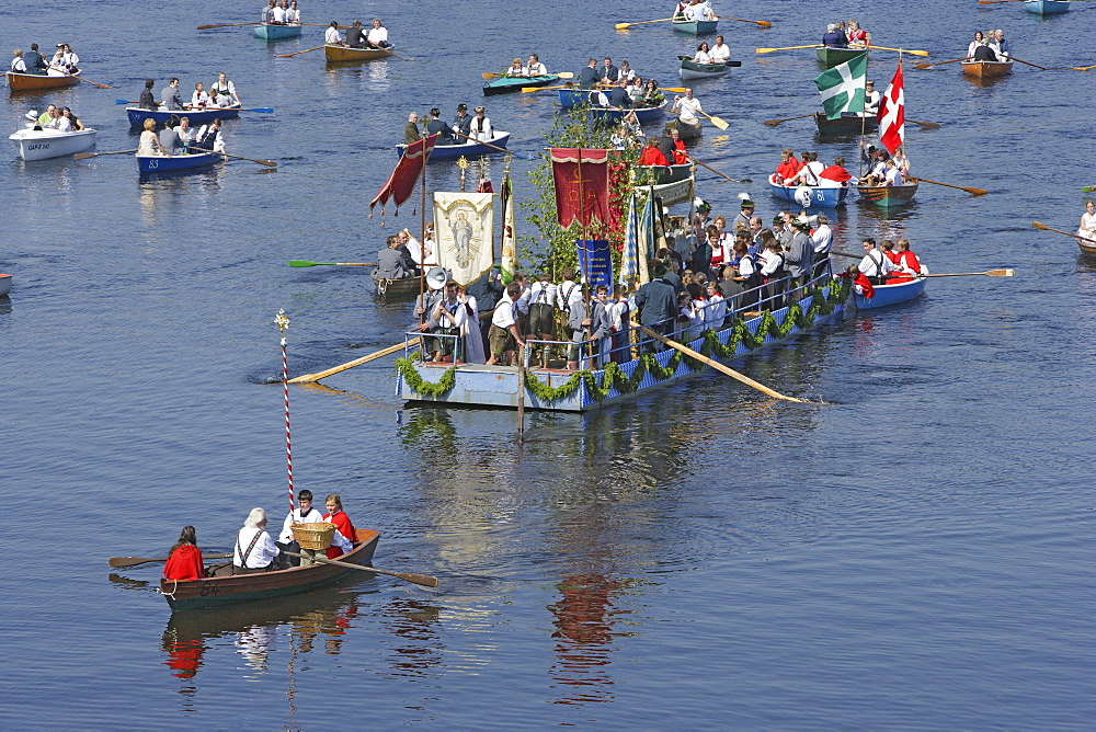 People in rowing boats, Boat procession at Corpus Christi at lake Staffelsee, Bavaria, Germany