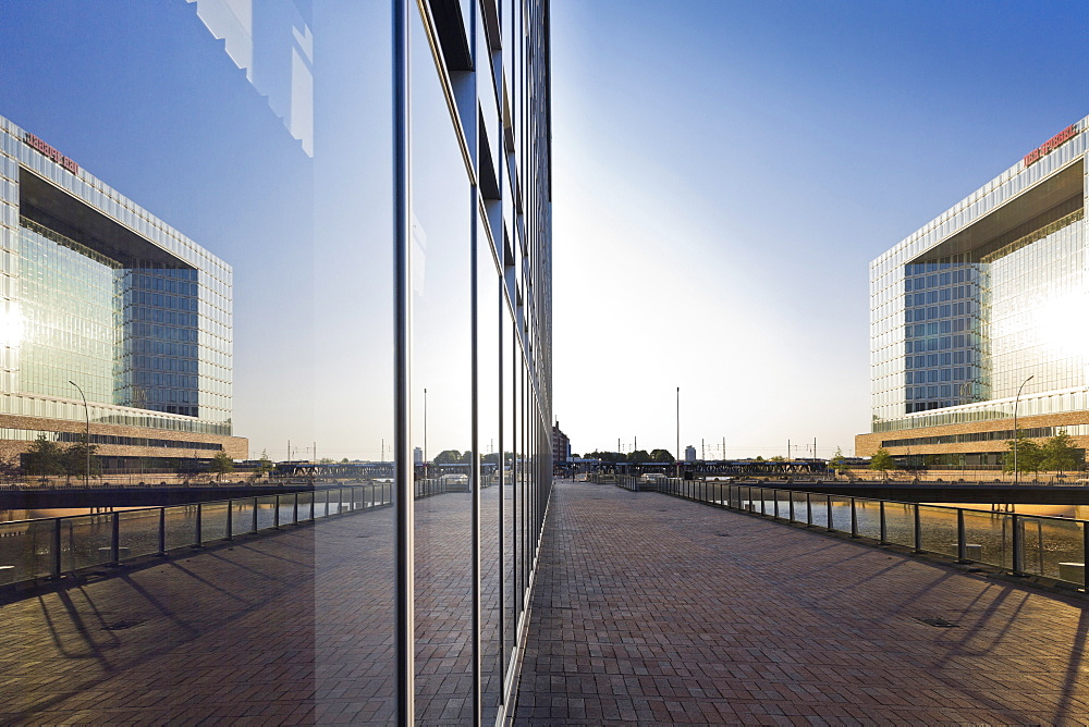 Reflection of Der Spiegel publishing house headquarters in the facade of the office building Deichtorcenter by Hadi Teherani, Oberhafen, Hamburg, Germany