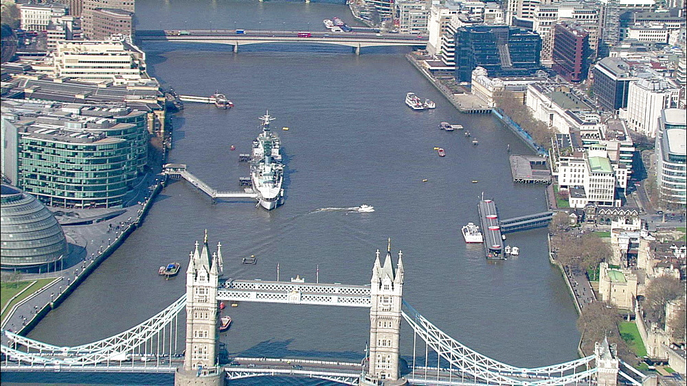 Aerial view of Tower Bridge, City Hall, HMS Belfast and River Thames facing West, London, UK - 1114-574