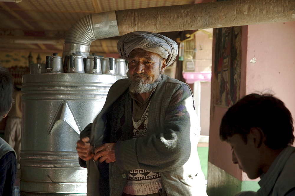 Afghan doctor dispensing medicines at a restaurant in Bamiyan, Bamian Province, Afghanistan