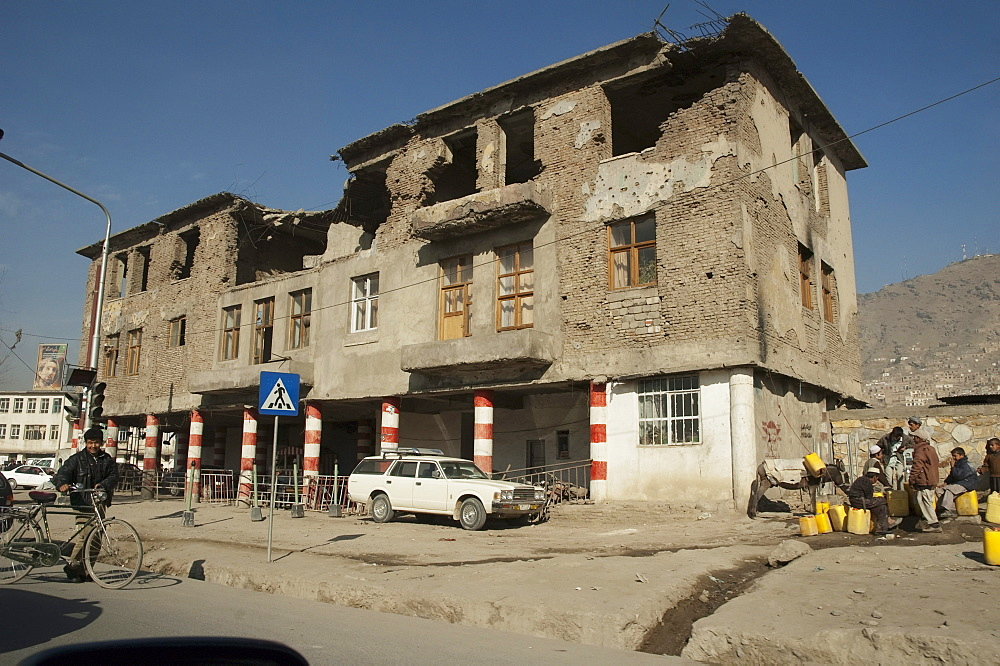 Albeit the top floor of this building in Kabul has been destroyed by shelling, the lower stories remain inhabited, , Afghanistan