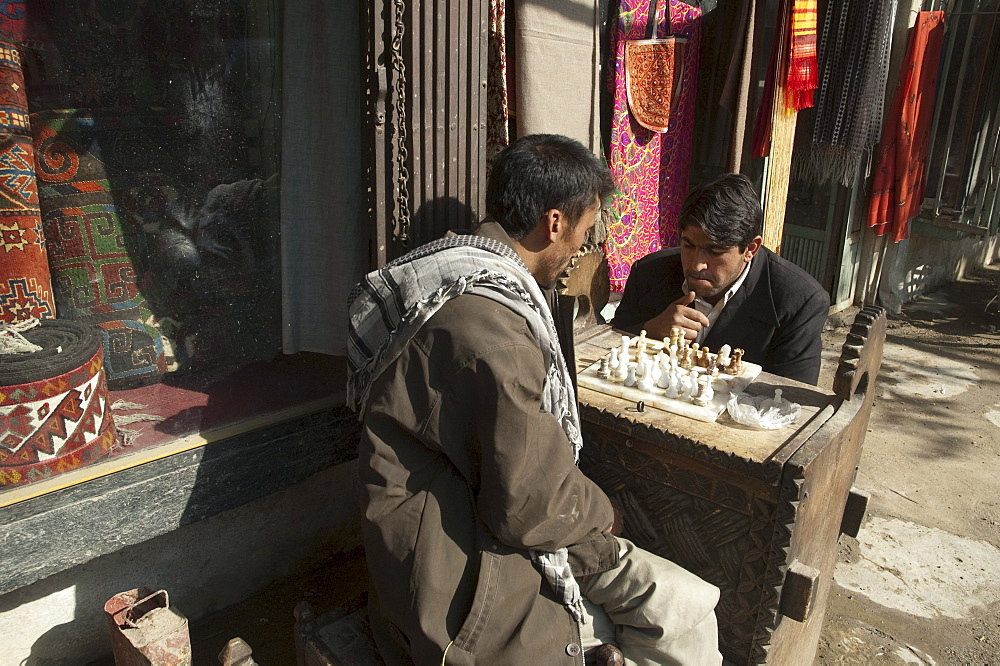 Afghan men playing chess on Chicken Street in Kabul, , Afghanistan