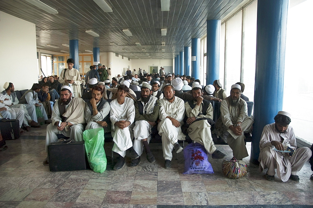 Passengers waiting at the main terminal building of the Kabul International Airport for the departure of their flight, , Afghanistan