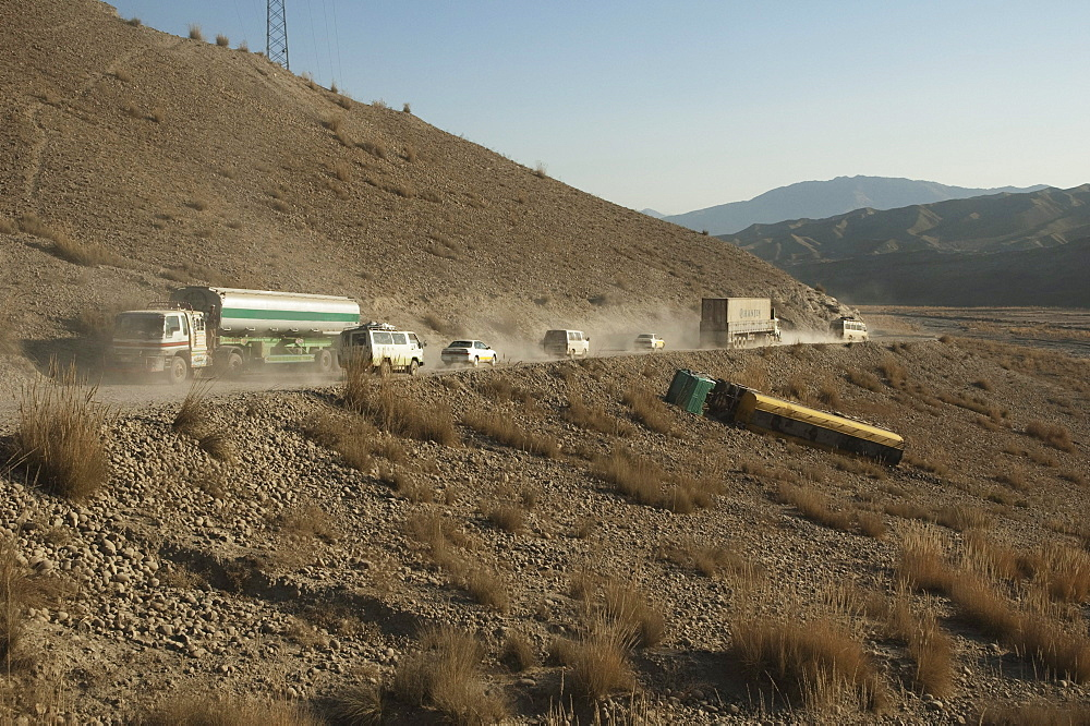 The overturned tanker truck couldn't handle the traffic on the dusty Kabul to Sarobi Road, Kabul Province, Afghanistan