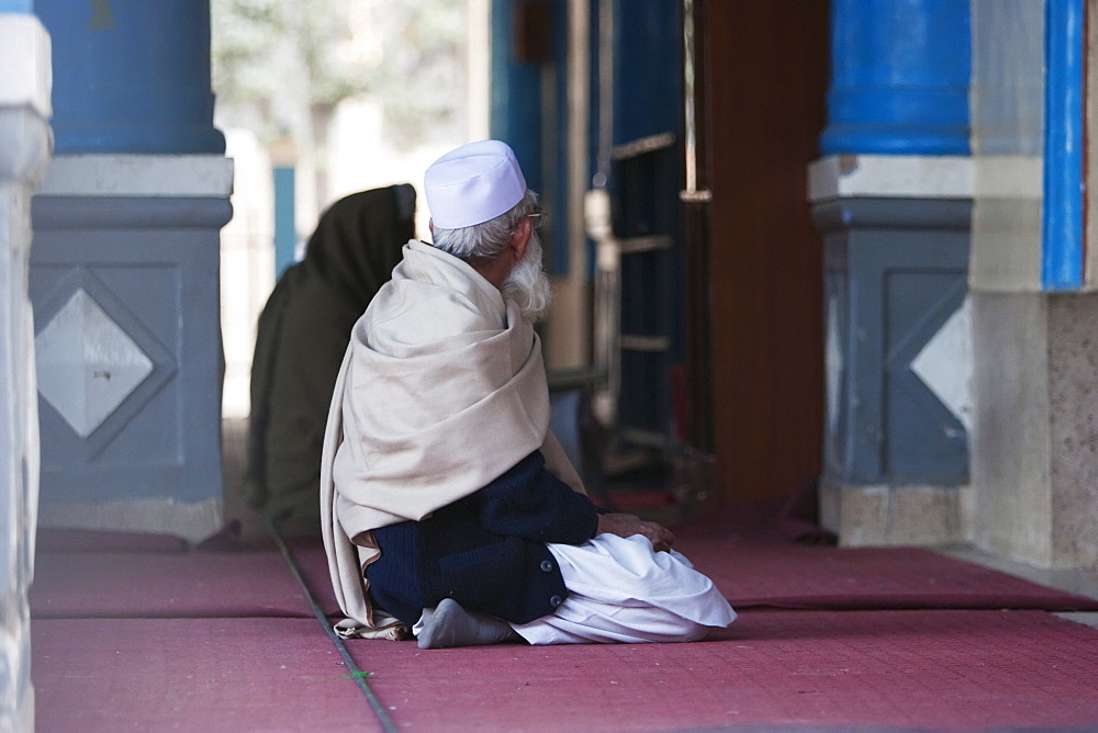 Man praying at the Mausoleum of Amir Habibullah in Jalalabad, Nangarhar Province, Afghanistan
