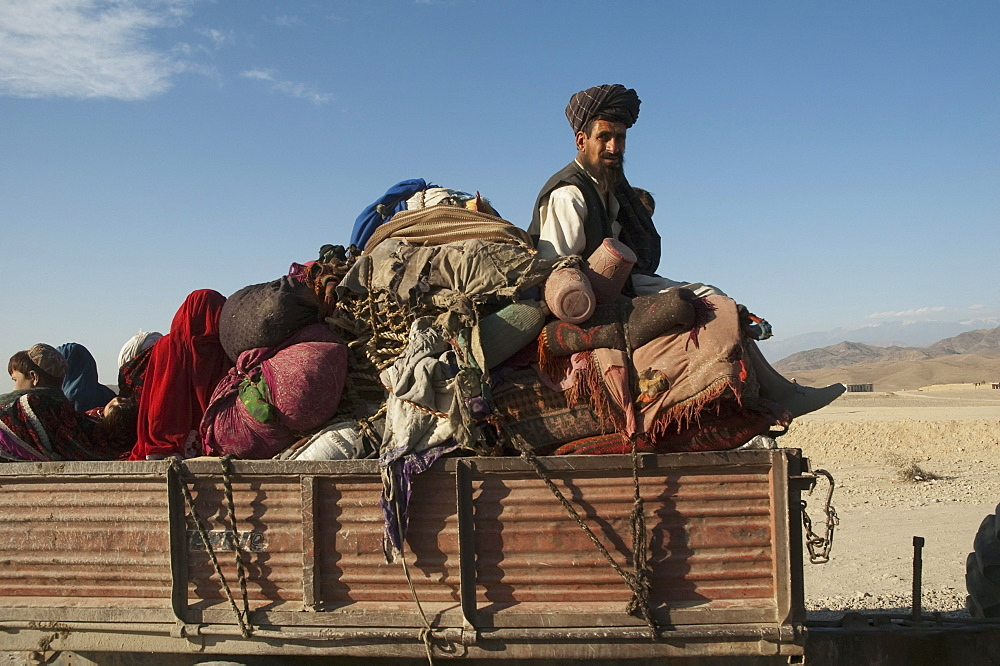 Returned Afghan refugee with his chattel on a truck on the Torkham to Jalalabad Road, Nangarhar Province, Afghanistan