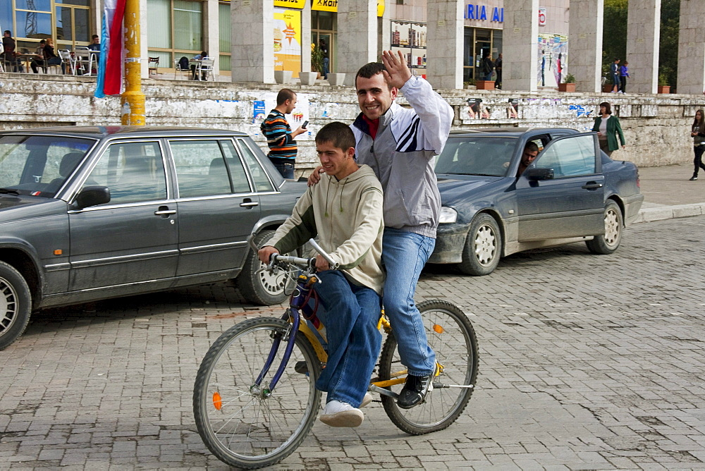 Men on a bicycle, Tirana, Albania