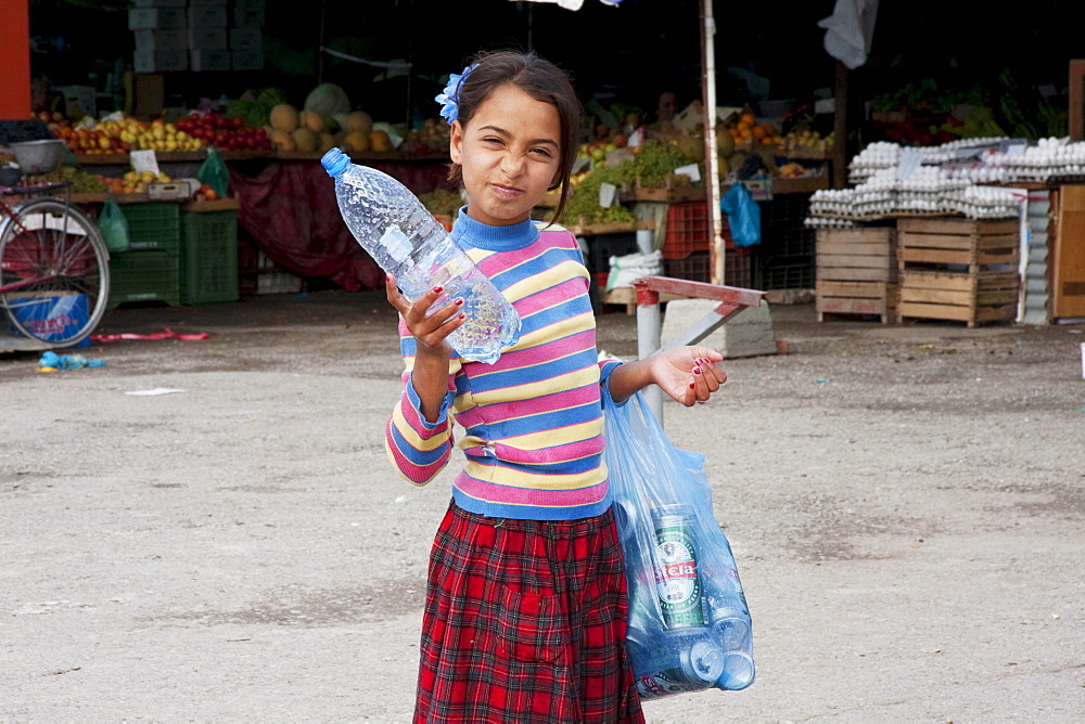 Girl collecting bottles, Tirana, Albania