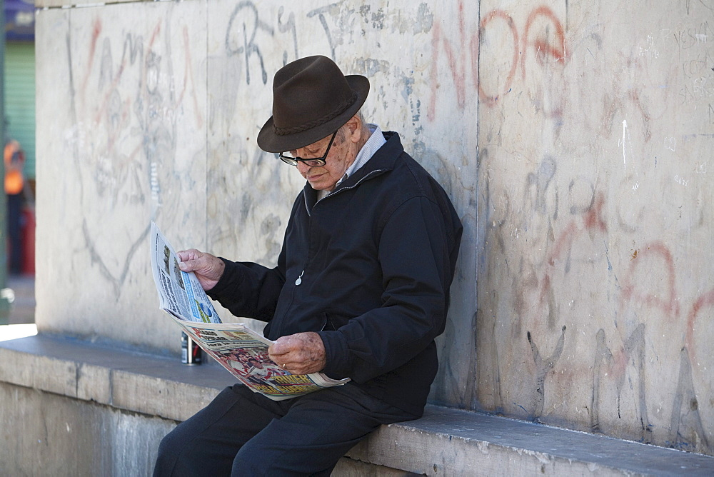 Old man with newspaper in Barrio La Boca, Buenos Aires, Capital Federal, Argentina