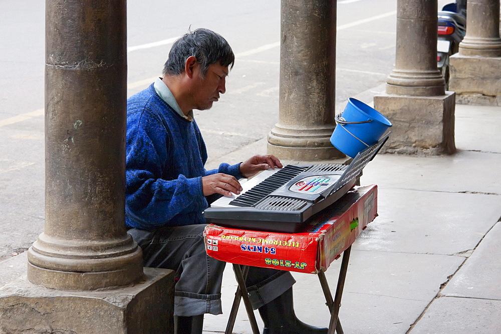 Blind man playing an organ, Cochabamba, Bolivia