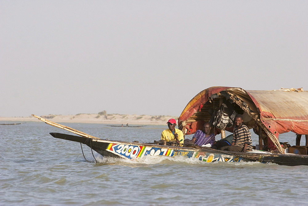 Pinasse carrying cargo and people on the Niger River between Niafunke and Kabara, Mali
