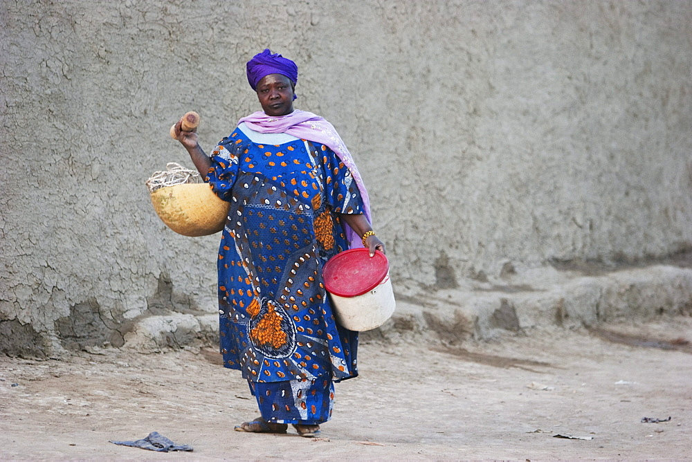 Woman carrying water in Djenne, Mali