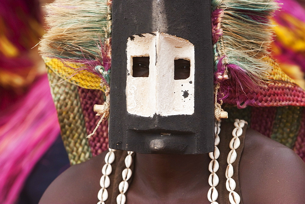 Dancer wearing Kananga mask at the Dama celebration in Tireli, Mali