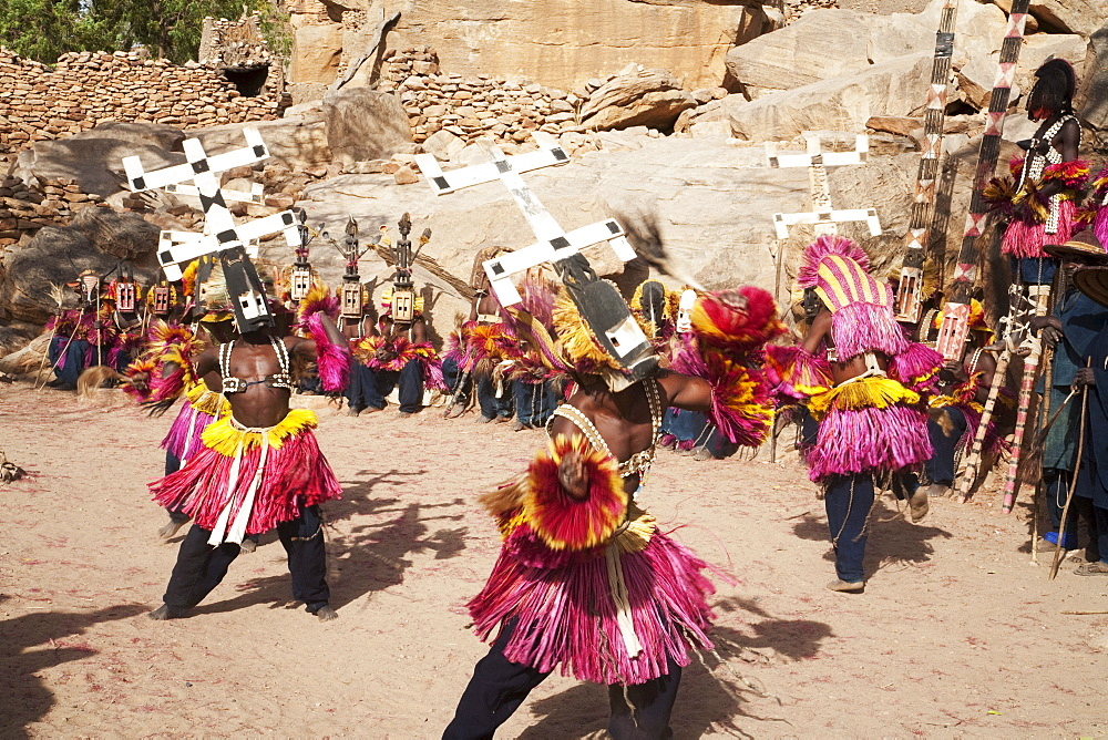 Dancers wearing Kananga masks perform at the Dama celebration in Tireli, Mali