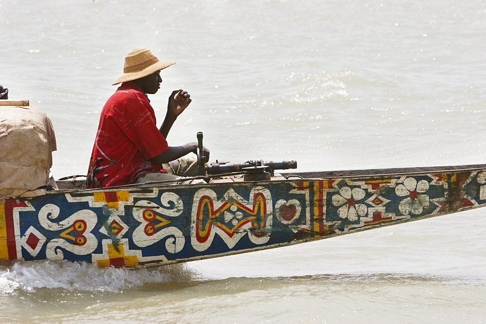Captain of a pinasse carrying cargo and passengers on the Niger River between Mopti and Lake Débo, Mali