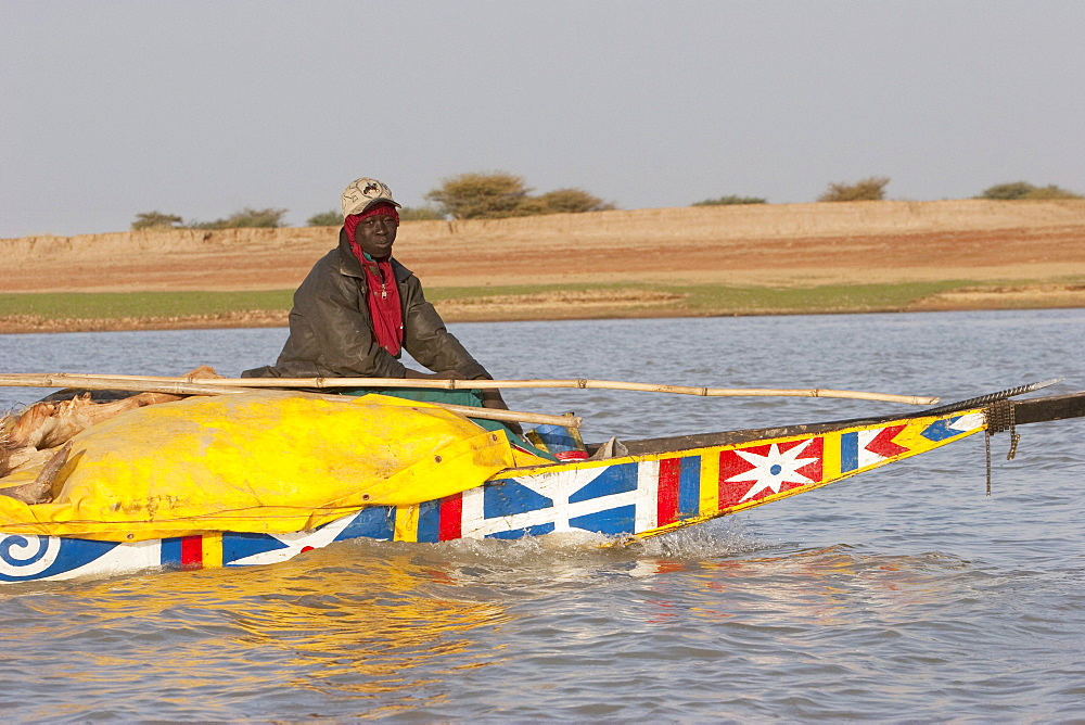 Man on a boat on the Niger River between Lake Débo and Sebi, Mali