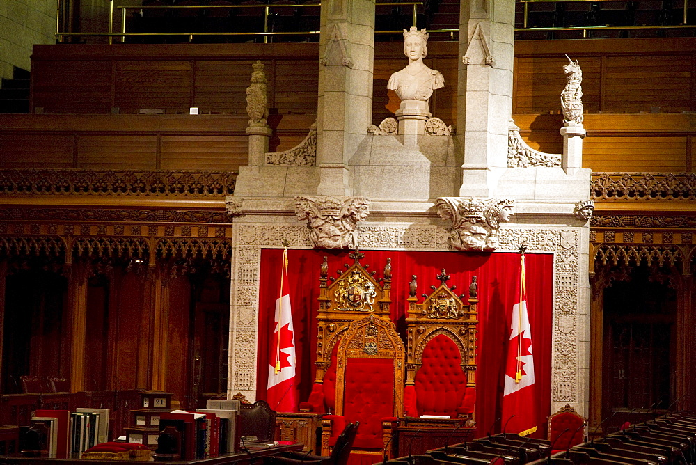 The throne and chair in the background are used by the queen and her consort, or the governor general and his or her spouse, respectively, during the opening of Parliament in the Senate Chamber in the Centre Block of tthe Parliament Buildings, Ottawa, Ontario, Canada