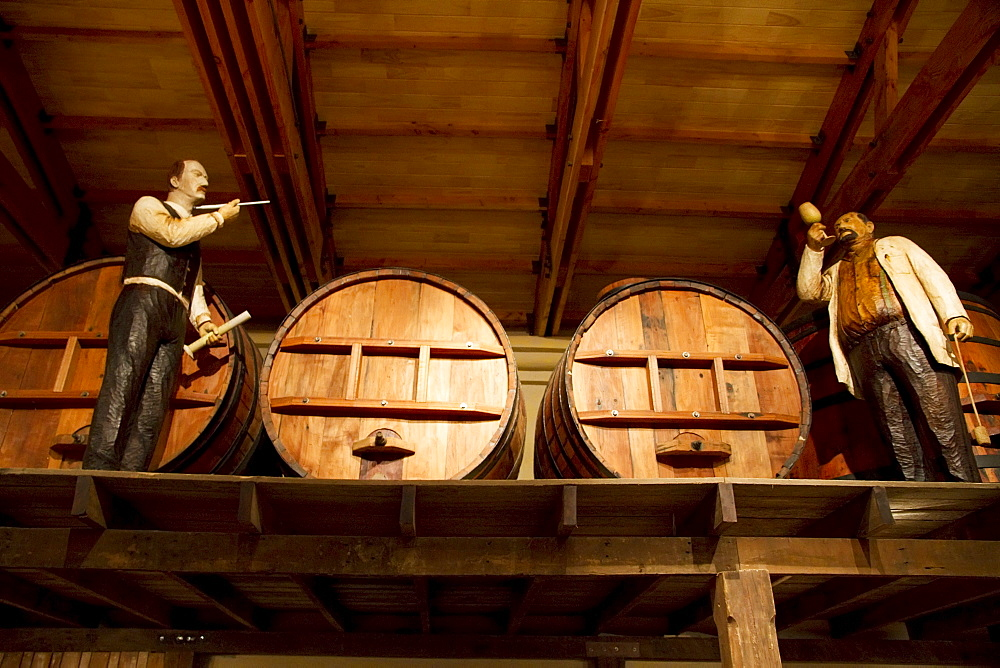 Life size handcrafted wooden figures illustrate the various stages of winemaking and distilling, as practiced in the 1900s, on display at the Wine Museum of Estancia El Cuadro, Casablanca Valley, Valparaiso Region, Chile