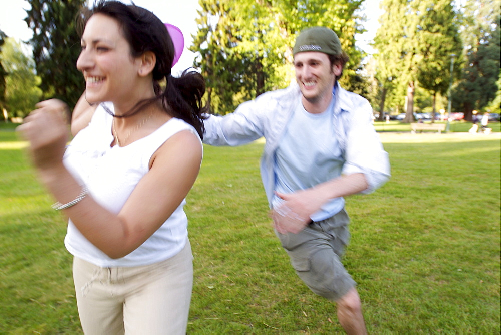 Couple Playing Frisbee in Park