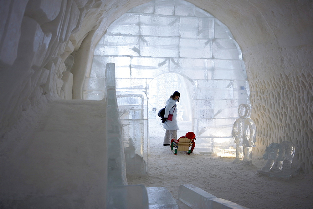 Woman and Son in Sled in Doorway of Ice Hotel, Quebec City, Quebec