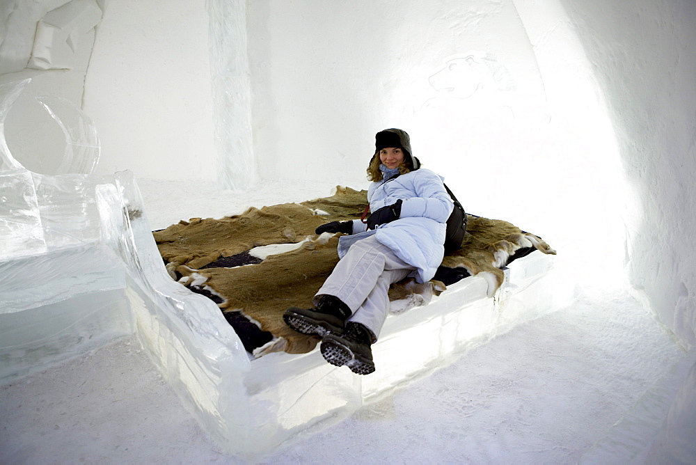 Woman in Ice Hotel, Lying on Bed with Furs, Quebec City, Quebec