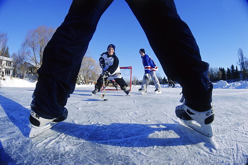 Boys Playing Hockey on Pond, Winnipeg, Manitoba