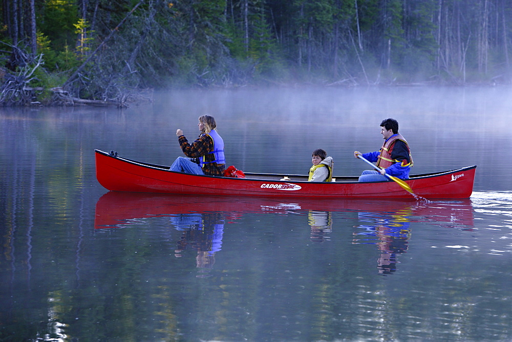 Family Canoeing on Trout Pond, Gaspesie Wildlife Reserve, Quebec
