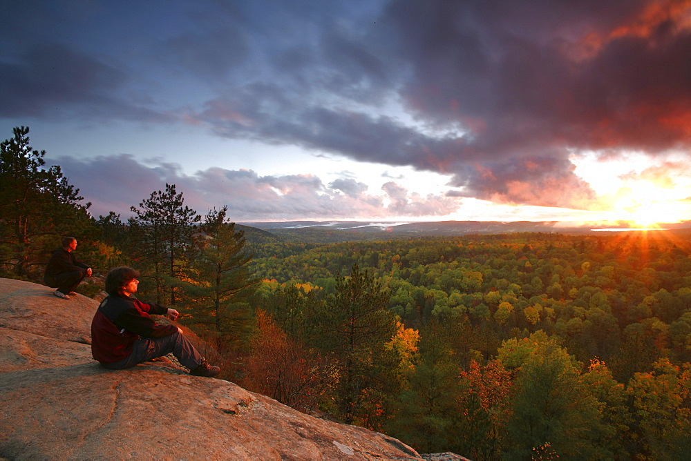 Hikers on Lookout Trail at Sunset in Autumn, Algonquin Park, Ontario