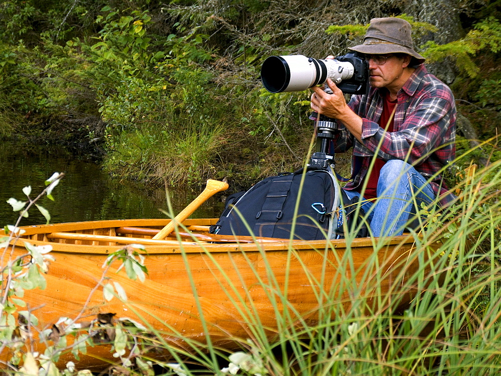 Photographer taking Pictures from a Canoe, La Mauricie National Park, Lac Soumire, Quebec
