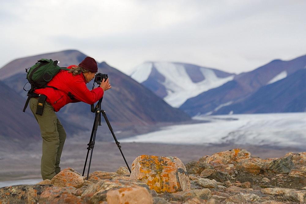 Photographer by glacier in Tay Bay, Sirmilik National Park, Nunavut, Canada