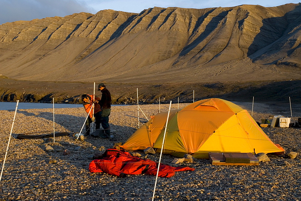 Tenting with electric bear fence, Tay Bay, Bylot Island, Sirmilik National Park, Nunavut, Canada