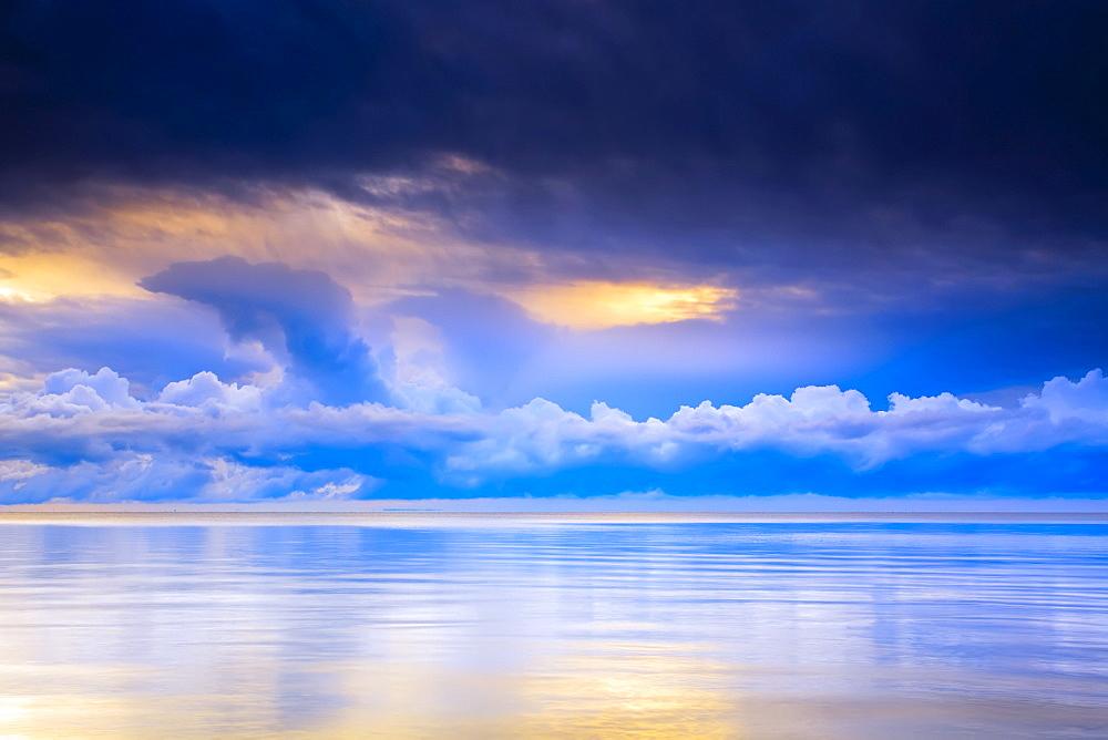 Storm clouds and Lake Winnipeg at sunrise, Gimli, Manitoba