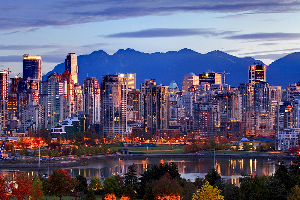 View of skyline with Yaletown, False Creek and North Shore Mountains, site of 2010 Winter Olympics, Vancouver, British Columbia