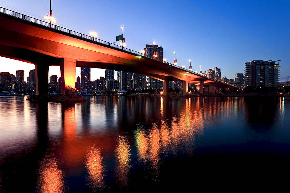 View under Cambie Street Bridge from False Creek to condominiums of Yaletown, Vancouver, British Columbia