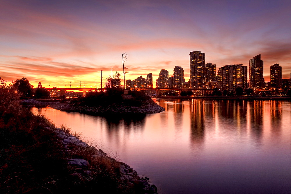 Night view from Athlete's Village to Yaletown condominiums and downtown, False Creek, Vancouver, British Columbia