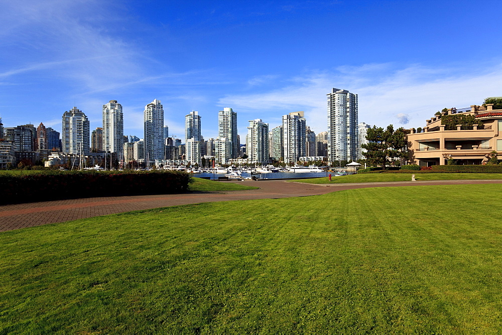 View across False Creek to condominiums of Yaletown and downtown, Vancouver, British Columbia