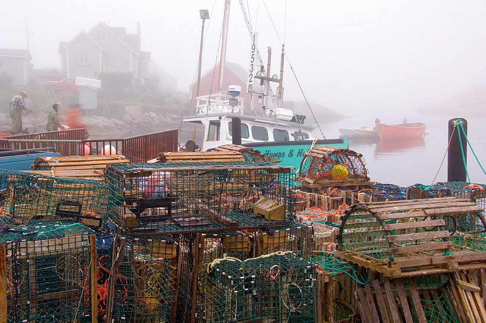 Lobster traps and fishermen, Peggy's Cove, Nova Scotia