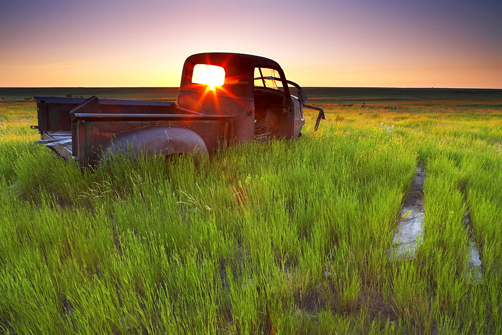 Old Abandoned Pick-Up Truck Sitting in a Field at Sunset, Southwestern Saskatchewan