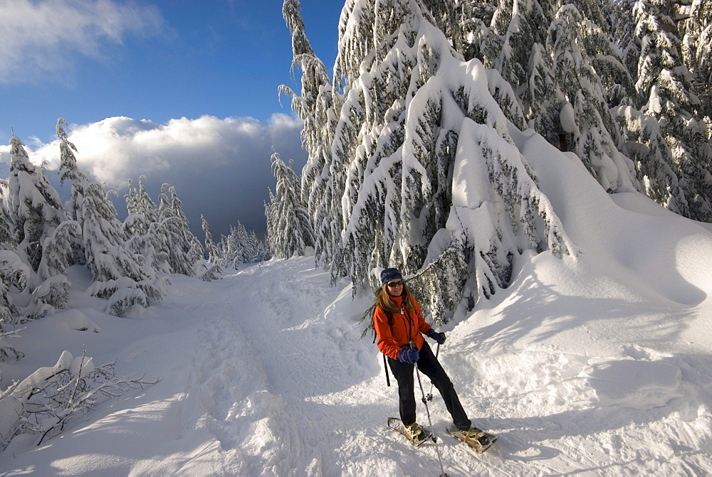 Portrait of a woman snowshoeing up Hollyburn Mountain, Cypress Provincial Park, near Vancouver, British Columbia