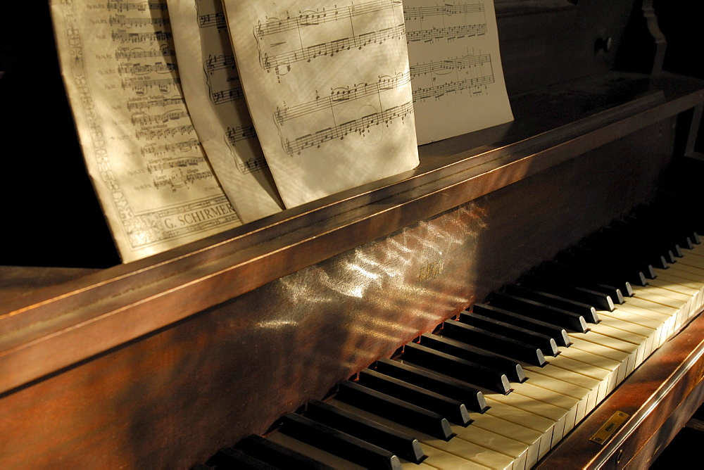 Piano and sheet music in window light, John Walter Museum, Edmonton, Alberta