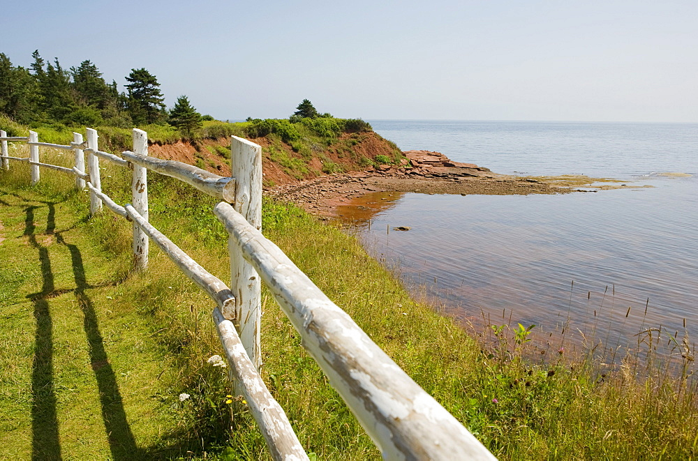 Wooden fence along the cliff tops overlooks the coastline, Cape Bear, Prince Edward Island