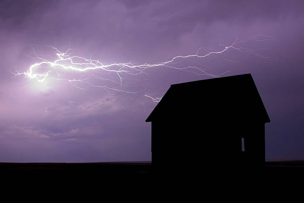 Lightning Storm over Abandoned Farm House in the Prairies. Val Marie, Saskatchewan