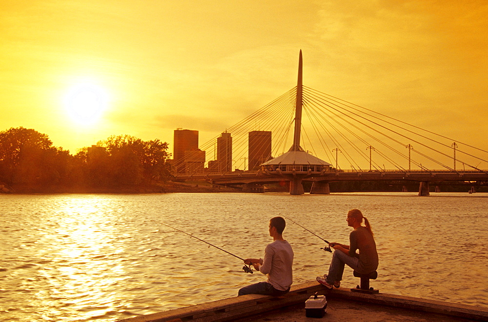Teens Fishing from a Dock with Red River in the background, Winnipeg, Manitoba