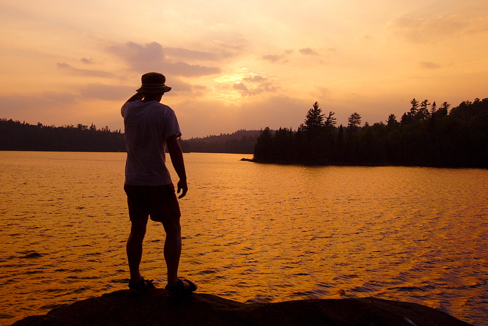 Man Standing on a Rock at Sunset, Lake Temagami, Temagami, Ontario