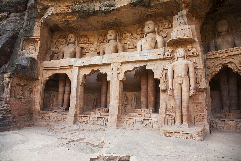 Jain sculptures carved in to the cliff on the southern approach to the fort, Gwalior, Madhya Pradesh, India