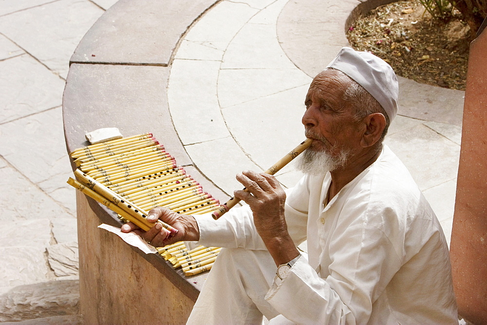 Man selling flutes, Amber Fort, Rajasthan, India