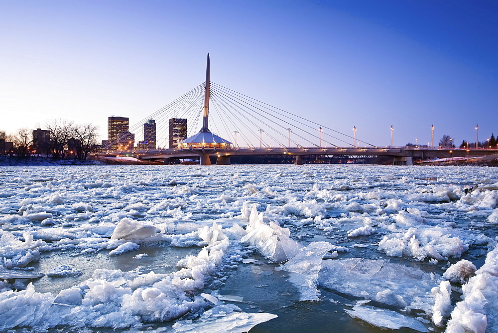 Ice on the Red River, Esplanade Riel Bridge and downtown in background, Winnipeg, Manitoba